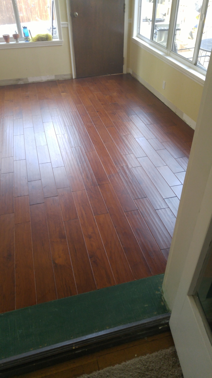 Ta da, the beautiful new wood floor in the kitchen! All thanks to Brian.
